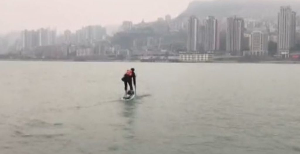 Liu Fucao paddling to work even in rainy days
